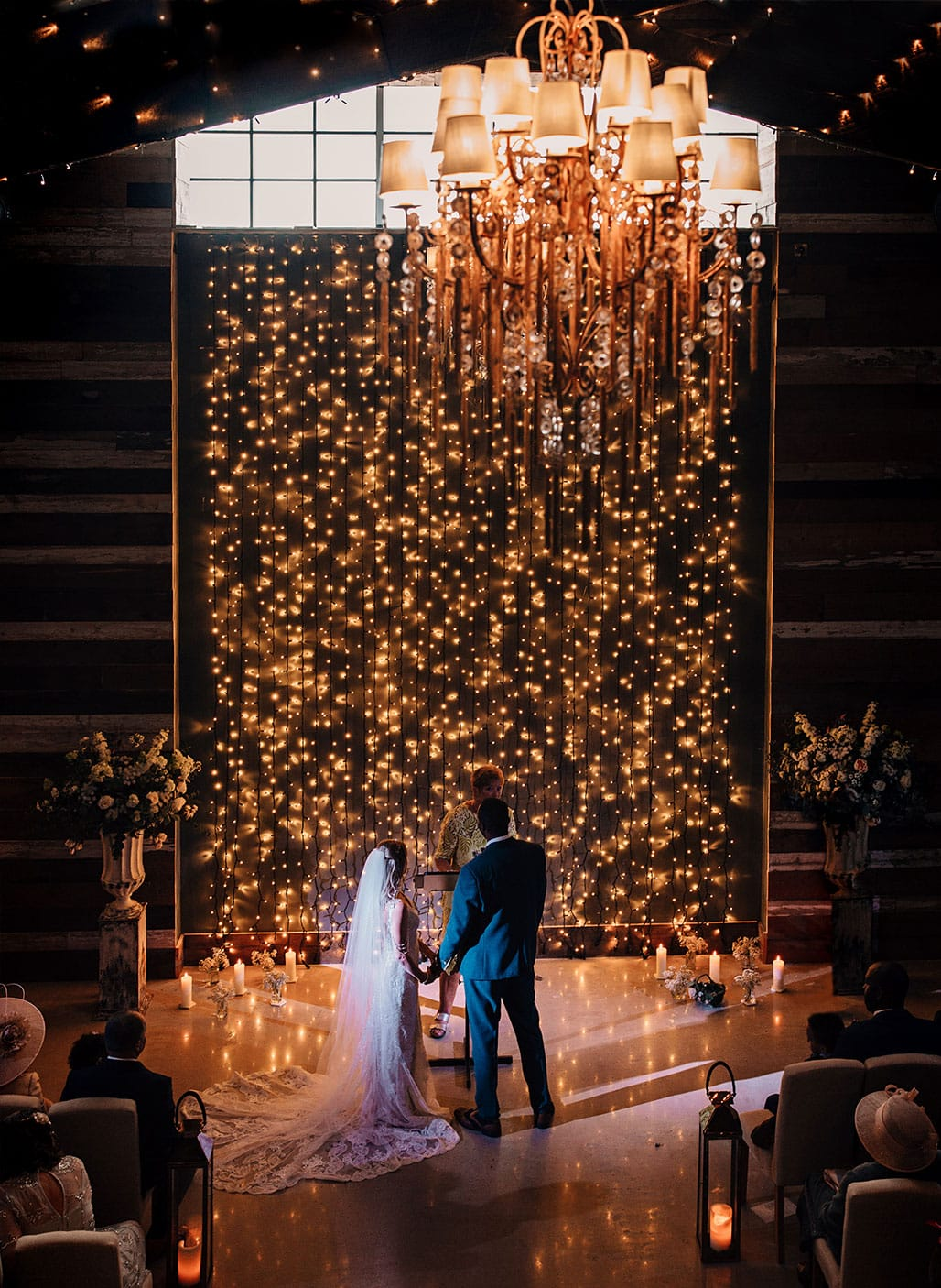 bride and groom infront of fairy light wall city centre wedding